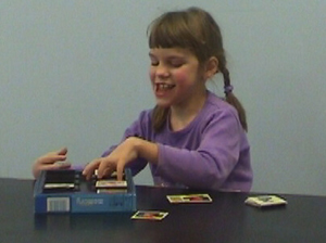 Mikaela is playing with cards