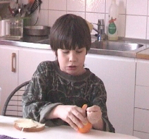 Niklas peeling an orange